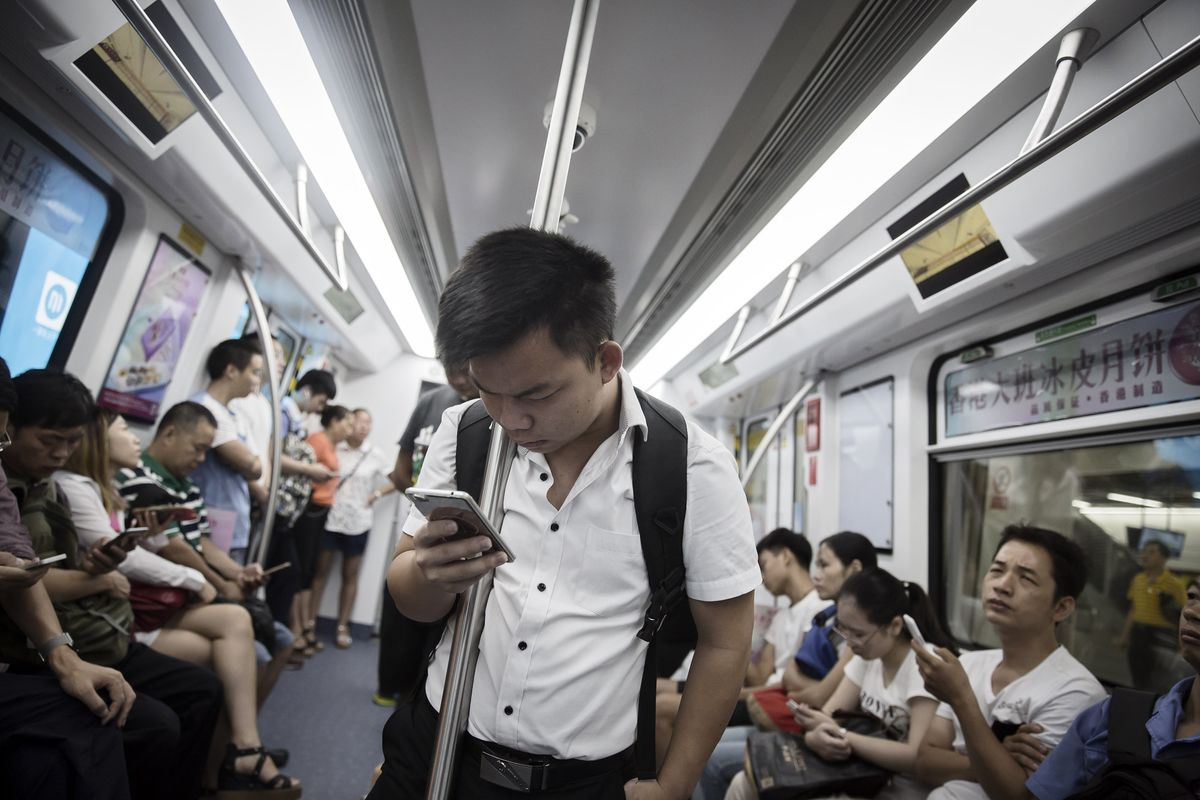 Who Wins and Loses If China Creates a New Mobile-Phone Giant