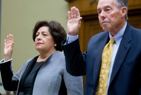 Katherine Archuleta, director of the U.S. Office of Personnel Management (OPM), left, and Patrick McFarland, inspector general of the OPM, swear in to a House Oversight and Government Reform Committee hearing on the OPM data breach in Washington, D.C., on June 24, 2015.