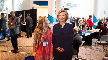 Kiersten lucas of phoenix poses with a cardboard cutout hillary clinton during the western conservative summit on june 27, 2015, in denver.
