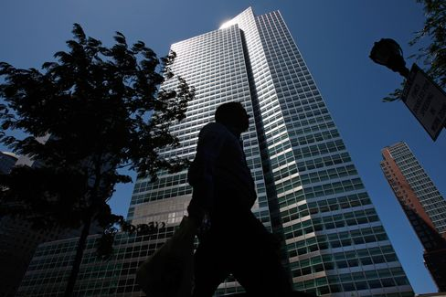 A pedestrian passes the headquarters of Goldman Sachs Group Inc., in New York.