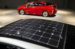 Solar panels are seen on the roof of Toyota Motor Corp.'s new Prius plug-in hybrid vehicles (PHV), known as Prius Prime in the U.S., at its sales launch at the National Museum of Emerging Science and Innovation in Tokyo, Japan, on Wednesday, Feb. 15, 2017. The Prius PHV/Prime is made in Japan and scheduled to begin sales in Europe and U.K. in March. Photographer: Tomohiro Ohsumi/Bloomberg