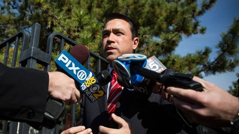 .S. Rep. Michael Grimm (R-NY) speaks to the media after voting on November 4, 2014 in the Staten Island borough of New York City.
