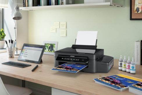 The new Epson printers can be fed by bottle.