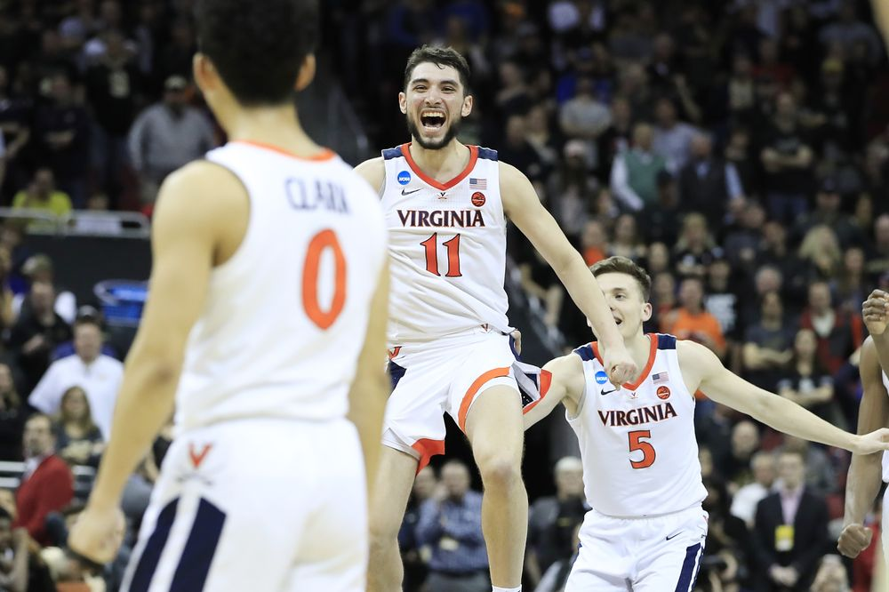 530e8f05b67 Ty Jerome of the Virginia Cavaliers reacts after they defeated the Purdue  Boilermakers 80-75
