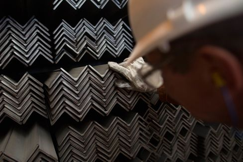 A worker inspects stores of finished steel angles at a steel mill in Cardiff, U.K., on May 18.