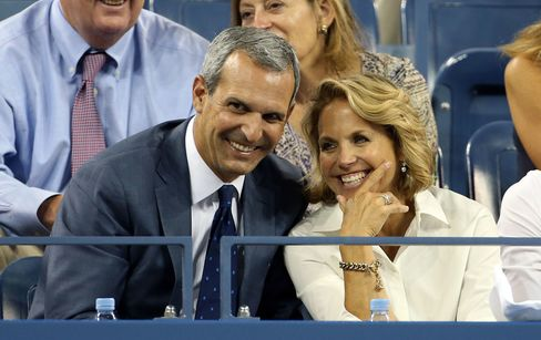 Katie Couric and husband John Molner attend Day 10 of the 2014 US Open at USTA Billie Jean King National Tennis Center in courtside seats.