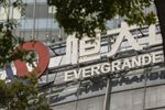 A China Evergrande Groupsign atop the Evergrande Center in Shanghai, China, on Wednesday, Sept. 15, 2021.