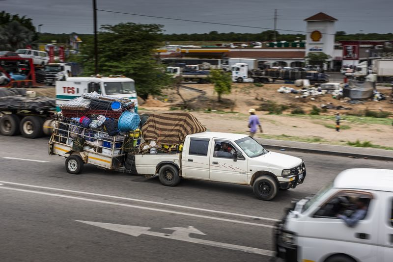 A truck tows a trailer loaded with goods near the border crossing with Zimbabwe.