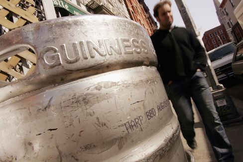 A man walks past kegs of beer piled up outside of a bar in preparation for St Patrick's Day celebrations March 16, 2005 in New York City. New York, one of the largest homes to Irish diaspora in America, is preparing for festivities to kick off around the city with the annual St. Patrick's Day Parade.