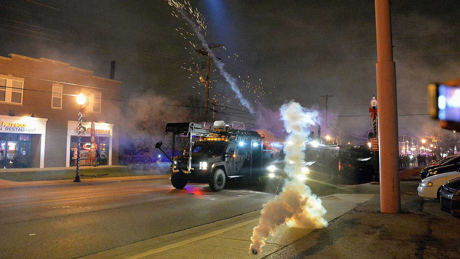 Police fire canisters of tear gas at demonstrators on Monday in Ferguson.