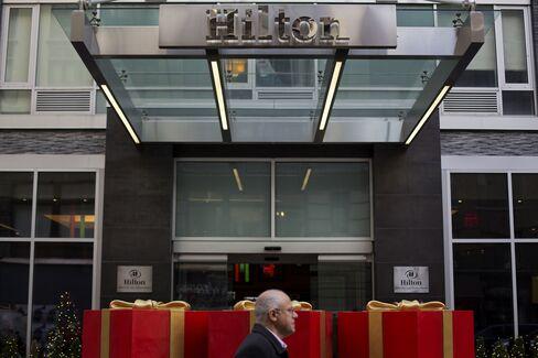 A Pedestrian Walks Past a Hilton Hotel in New York