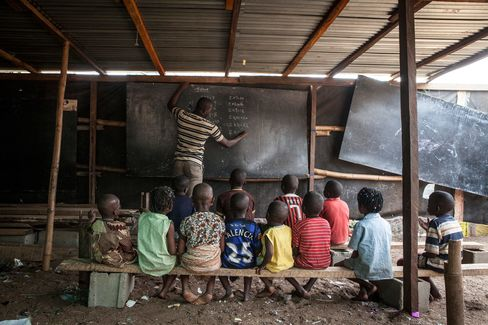 Students attend class at a ramshackle school in the Mokoko slum in Lagos, Africa's largest city.