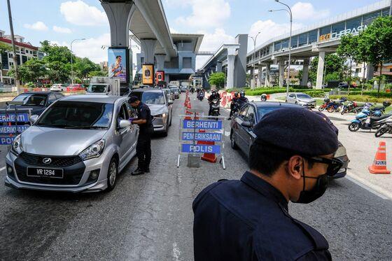 Malaysians' Desperation Grows as Politics Cloud Virus Action
