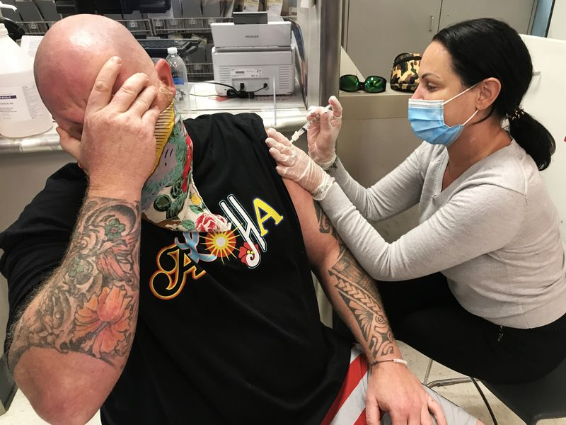 Shane Curran, fear of needles, gets his vaccine against COVID-19 - during the Coronavirus pandemic.