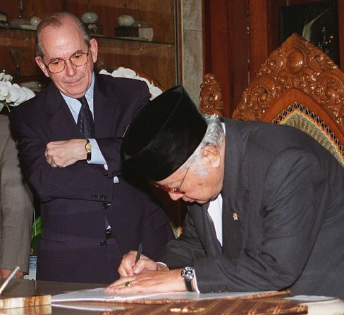Indonesian President Suharto signs a letter of agreement before International Monetary Fund (IMF) Director-General Michel Camdessus at Suharto's residence in Jakarta, Indonesia, on Jan. 15, 1998.