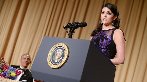 President Barack Obama listens as Cecily Strong speaks at the White House Correspondents' Association dinner on April 25, 2015, in Washington.