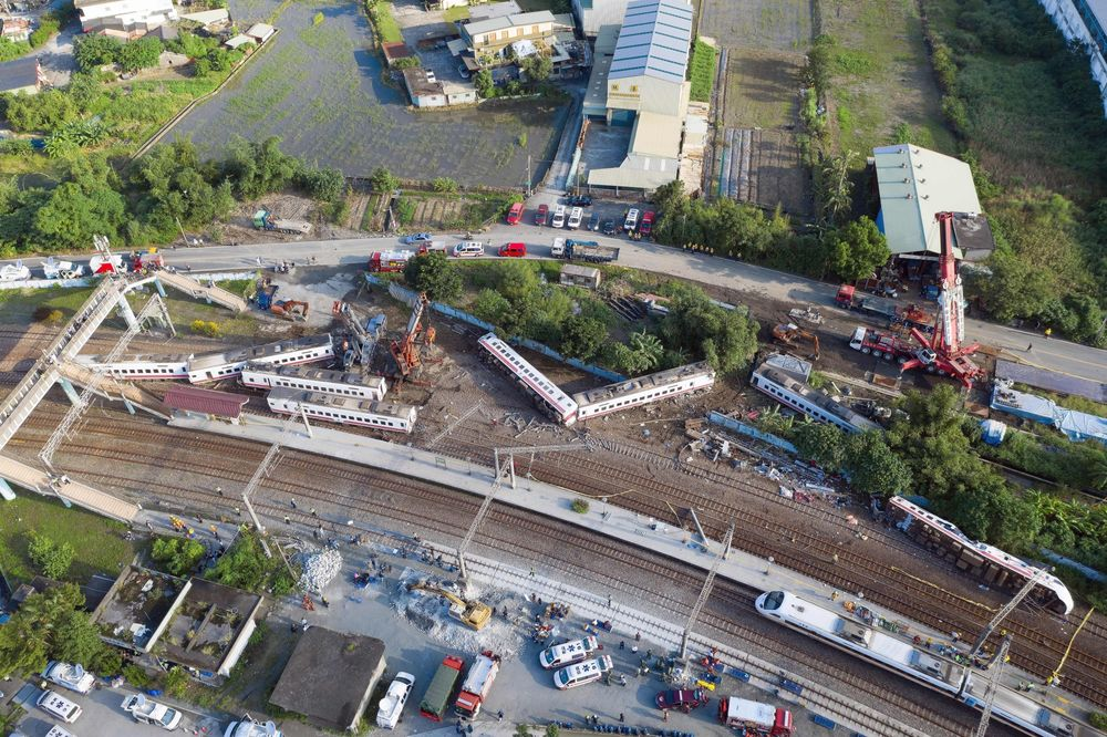 One Of Taiwans Fastest Trains Derails Killing At Least 18 Bloomberg