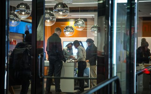 Operations Inside An AT&T Inc. Store Ahead of Earnings Figures
