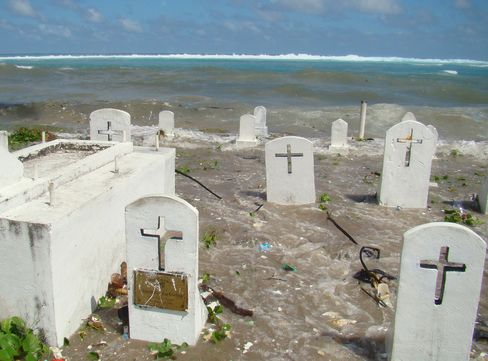 A cemetery on the shoreline in Majuro Atoll being flooded from high tides and ocean surges in the Marshall Islands.