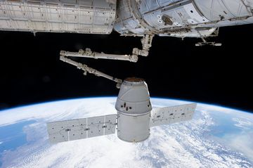The Dragon outside the International Space Station.