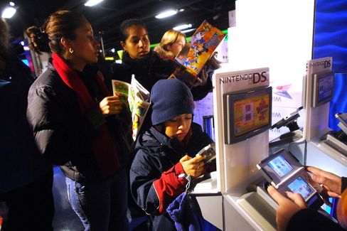"""Shoppers at the Toys """"R"""" Usin Times Square in Manhattan, N.Y."""