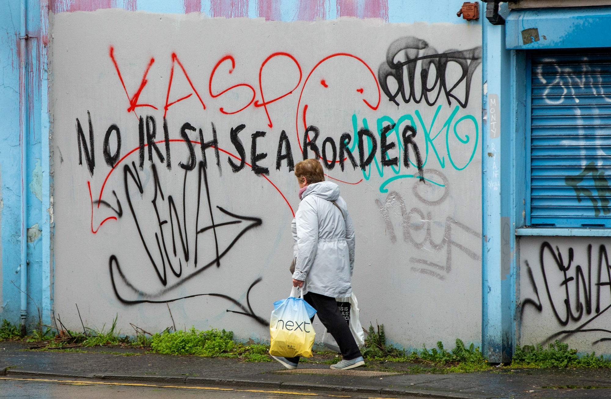 "Graffiti on a building says ""No boundary of the Irish Sea"" in the Sandy Row area of ​​Belfast."