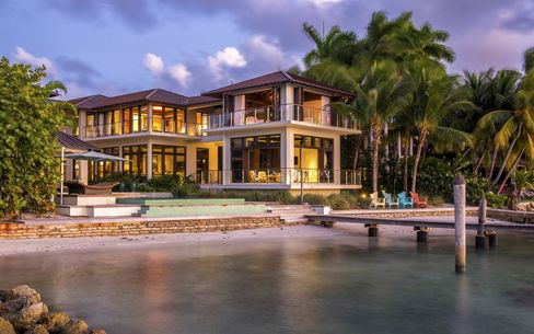 Johnny Lopez's Key Biscayne, Fla., mansion, with private dock, is on the market for $21 million. Lopez is a film producer and co-owner of theDetroit Pistons.