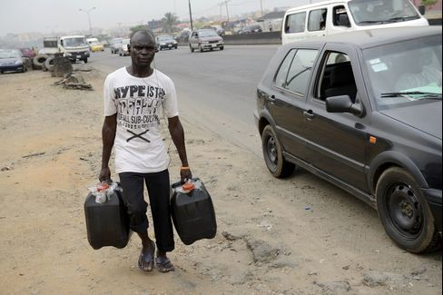A Man Carries Fuel In Jerry Cans