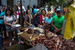 Customers stand in line to buy unregulated meat from a street vendor during a beef shortage in Caracas, Venezuela, on Monday, Dec. 18, 2017.