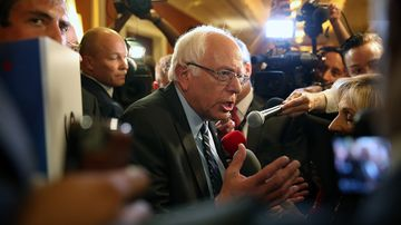 Democratic presidential candidate Bernie Sanders is interviewed as he leaves the spin room after he took part in a presidential debate sponsored by CNN and Facebook at Wynn Las Vegas on Oct. 13, 2015.