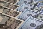 Japanese 10,000 yen and U.S. 100 dollar banknotes are arranged for a photograph in Tokyo, Japan.
