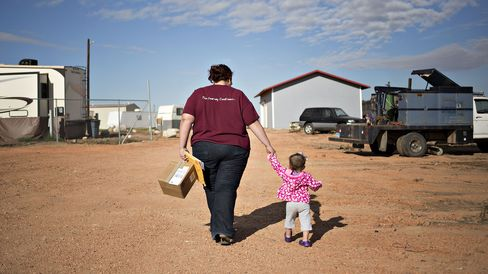 Angela Krohn walks with her daughter in Watford City.
