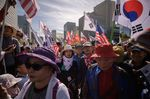 Anti-government activists rally in Seoul on Oct. 9.