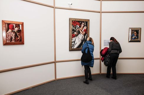 Visitors at an exhibition of Tamara de Lempicka's work in Torino, Italy, in 2015.