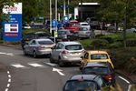 Vehicles queue for fuel at a service station in London on Sept. 26.