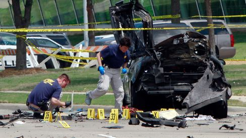 FBI investigators work a crime scene outside of the Curtis Culwell Center after a shooting.
