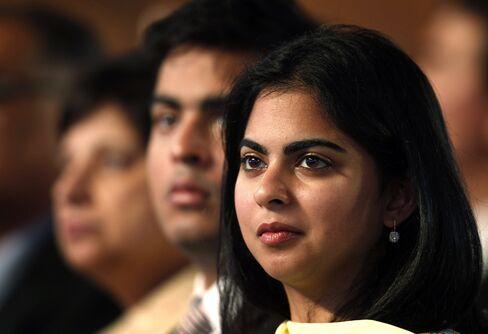 Isha Ambani, right, and Akash Ambani, second right.