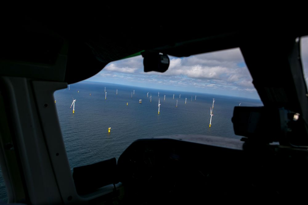 Wind Turbines Stand In The North Sea Off The Coast Of The Hel Land Archipelago In Germany