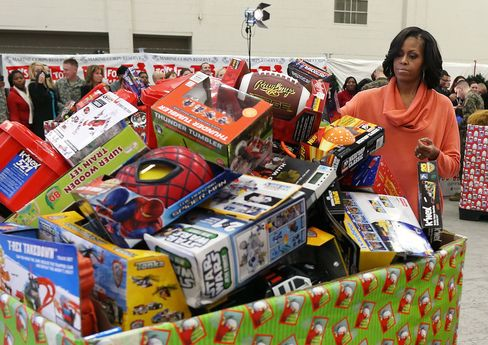 First Lady Michelle Obama helps sort toys at Joint Base Anacostia-Bolling