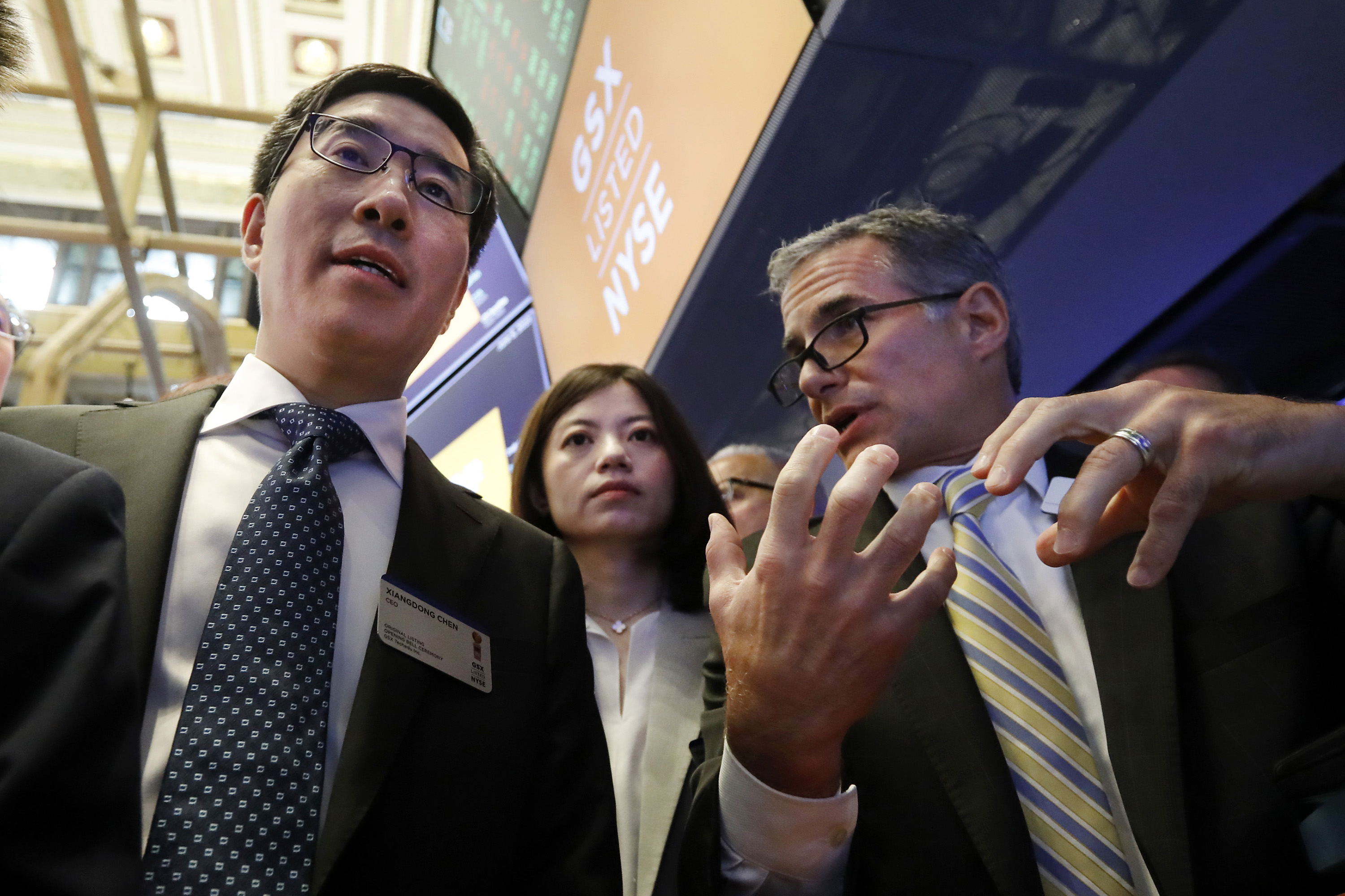Larry Chen, left, and company CFO Nan Shen during their IPO atthe New York Stock Exchange in 2019.