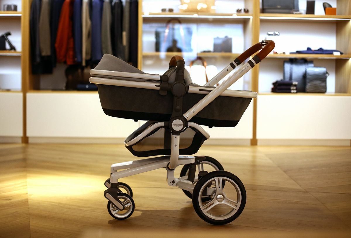 Aston Martin Moves Beyond James Bond With Boats Baby Strollers - Aston martin stroller