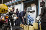 An attendant fills plastic fuel containers at the Euro Petroleum petrol station in the Baba Dogo suburb of Nairobi, Kenya, onMarch 28.