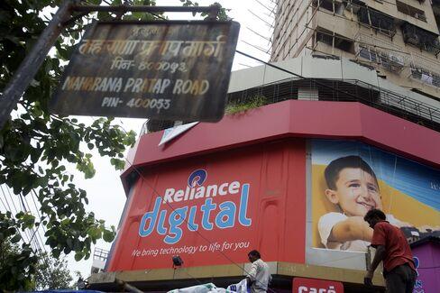 Billionaire Ambani Bucks Loan Slump as Rupee Drops