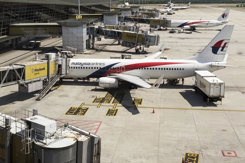 Images Of Malaysian Airlines As Carrier Bans Checked Bags Over Fears Headwinds Could Leave Jets Short on Gas
