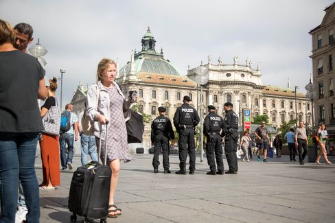 Police officers stand guard in Munich on July 23.