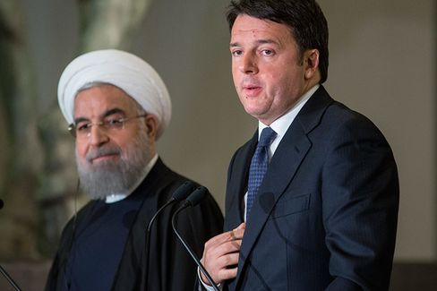 Matteo Renzi, Italy's president, left, speaks during a joint news conference with Hassan Rouhani, Iran's president, at Chigi palace
