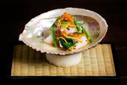 Raw scallop, pickled lotus root and ichiban dashi infused vegetables.