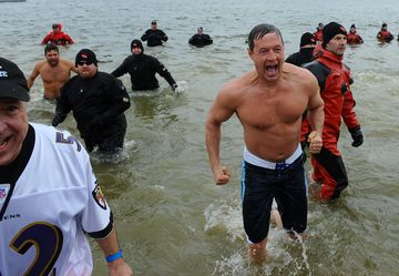 Maryland Governor Martin O'Malley lets out a scream as he jumps out of the Chesapeake Bay as he participates in the 15th annual Polar Bear Plunge on January 29, 2011 in Annapolis, Md.