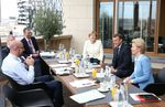 EC President Charles Michel (L), Germany's Chancellor Angela Merkel (C), France's President Emmanuel Macron (2nd R) and President of the European Commission Ursula von der Leyen during a bilateral meeting at the EU summit on a coronavirus recovery package.