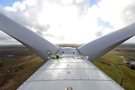A job not for the acrophobic. An employee closes the nacelle hatch of a Vestas V126 wind turbine, 140 meters off the ground. The blade adds another 80 meters to the structure's height.